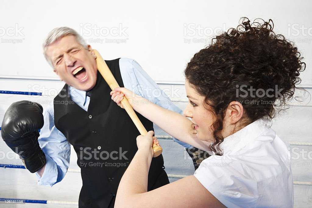 Business Man And Young Woman Fighting stock photo