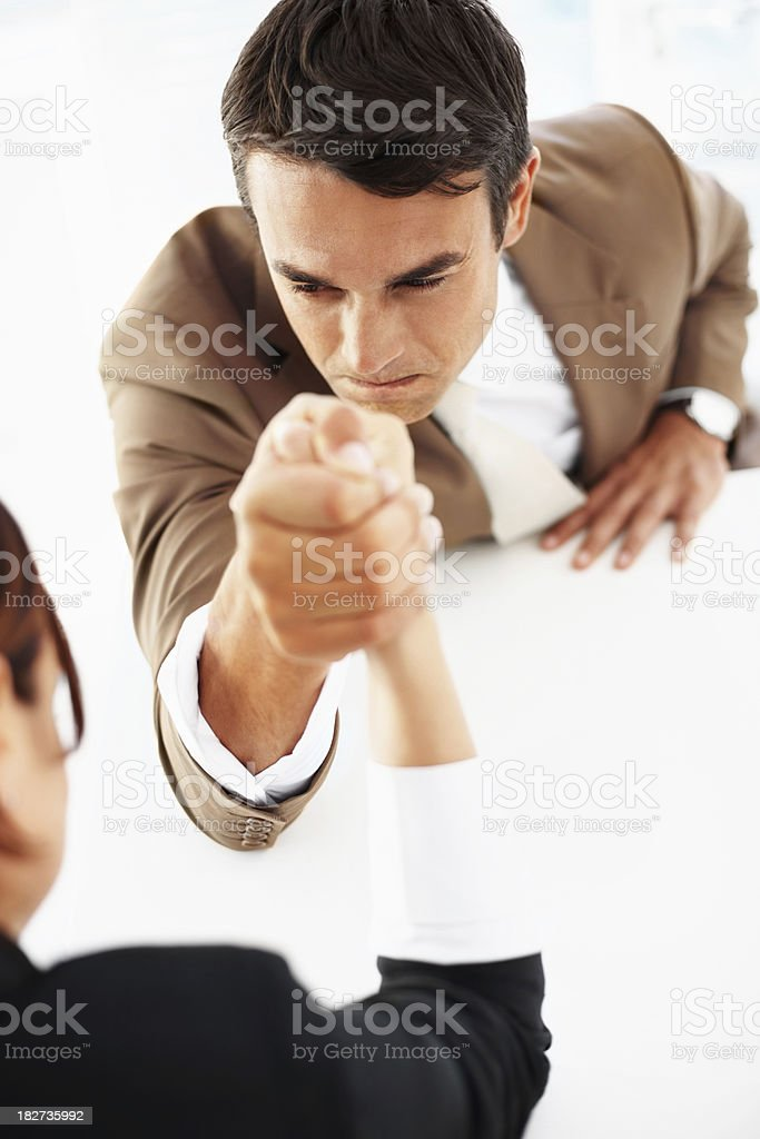 Business man arm wrestling with a colleague royalty-free stock photo