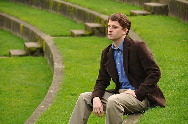 Business Man at Park Contemplating stock photo