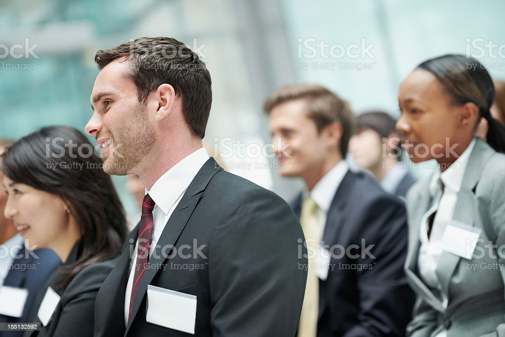 Business man attending seminar with colleagues royalty-free stock photo