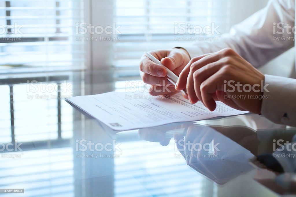 business man before signing contract stock photo