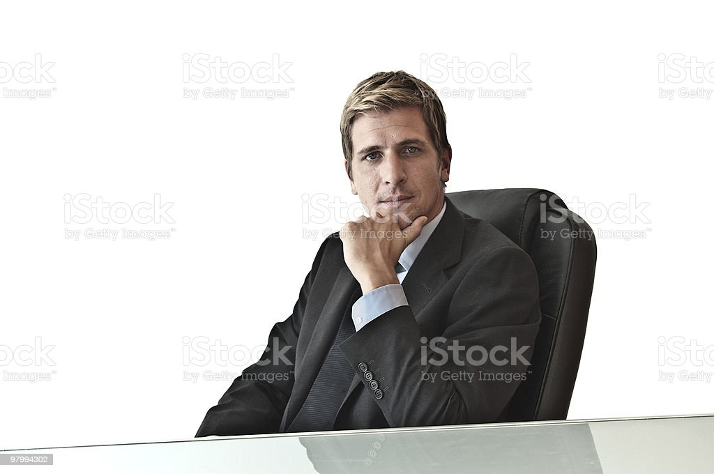 Business man behind a desk royalty-free stock photo