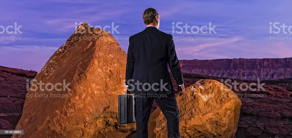 Business Man Between Rock and a Hard Place royalty-free stock photo