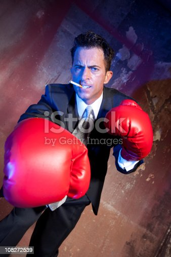 464164875 istock photo Business man boxing 108272539