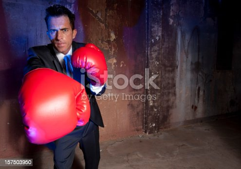 464164875 istock photo Business man boxing 157503950