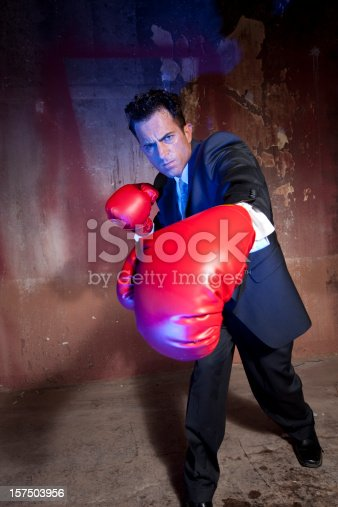 464164875 istock photo Business man boxing 157503956