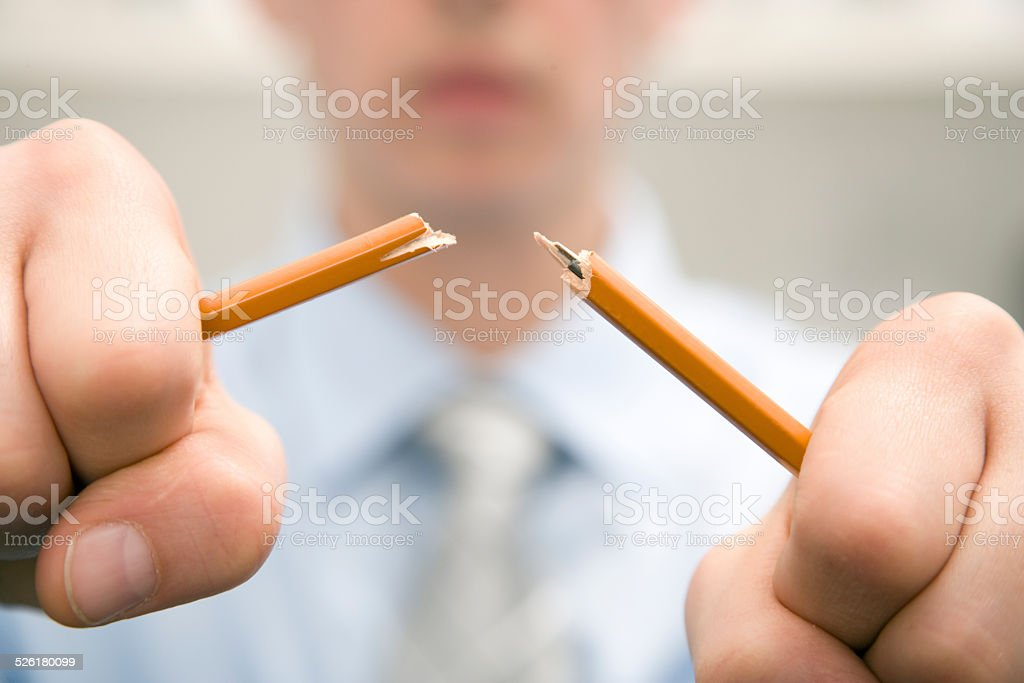 Business Man Breaking Pencil stock photo