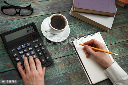istock Business man calculate about cost and doing finance at office 941746764