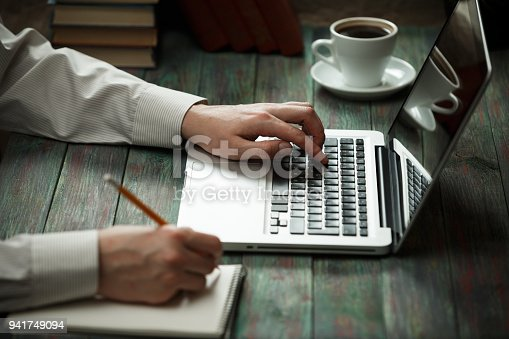 istock Business man calculate about cost and doing finance at office 941749094