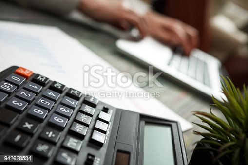 645670208istockphoto Business man calculate about cost and doing finance at office 942628534