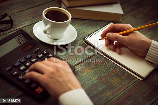 istock Business man calculate about cost and doing finance at office 944318374