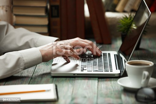istock Business man calculate about cost and doing finance at office 944325534