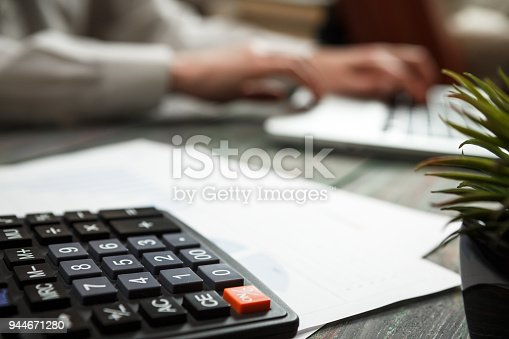 istock Business man calculate about cost and doing finance at office 944671280