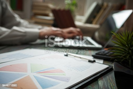 istock Business man calculate about cost and doing finance at office 944671890