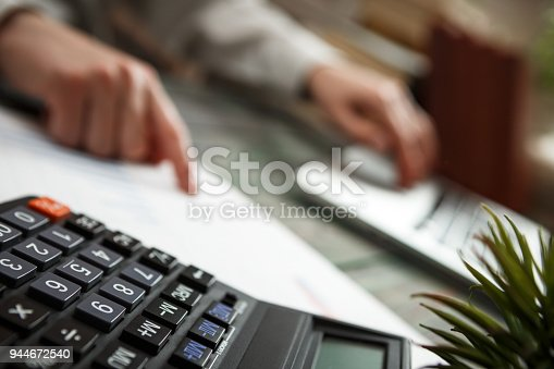 645670208istockphoto Business man calculate about cost and doing finance at office 944672540