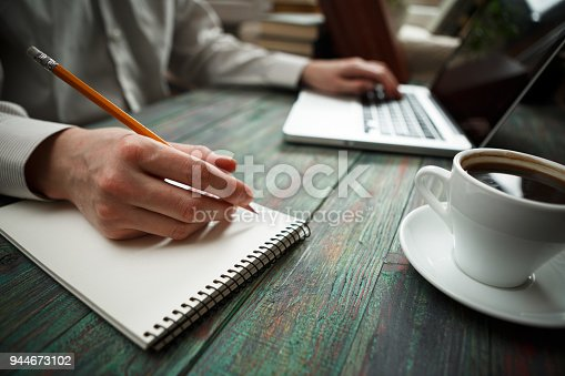 645670208istockphoto Business man calculate about cost and doing finance at office 944673102
