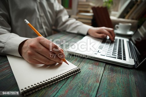 645670208istockphoto Business man calculate about cost and doing finance at office 944675578