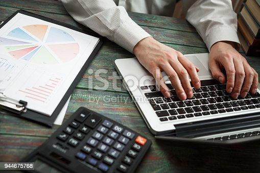 645670208istockphoto Business man calculate about cost and doing finance at office 944675768