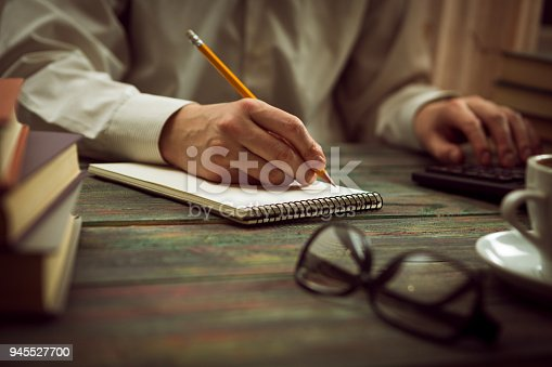 istock Business man calculate about cost and doing finance at office 945527700