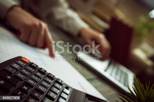 645670208istockphoto Business man calculate about cost and doing finance at office 945527928