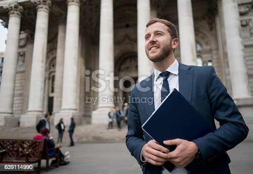 istock Business man carrying a tablet computer 639114990