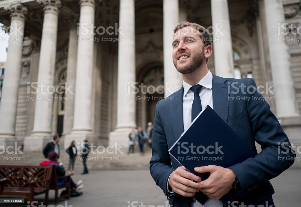 Business man carrying a tablet computer stock photo