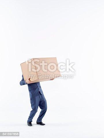 istock Business man carrying cardboard box 541597858