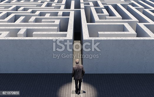 istock Business man challenge endless maze, business strategy concept 621370920