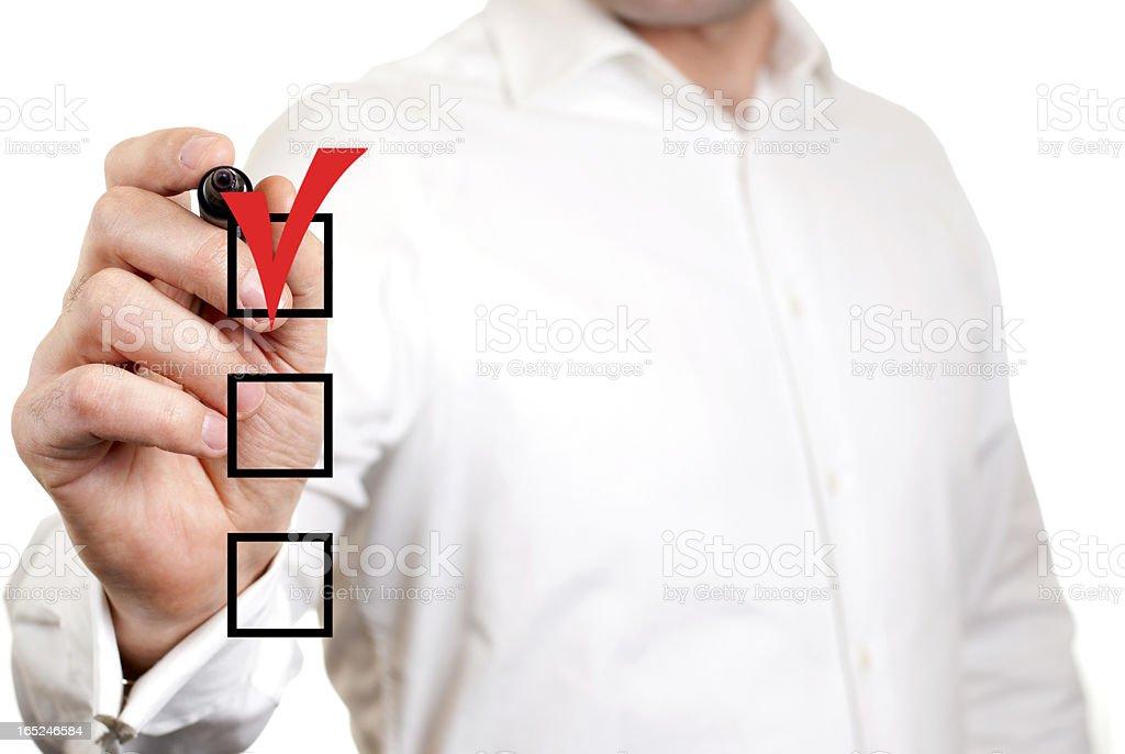 A business man checking a check box royalty-free stock photo
