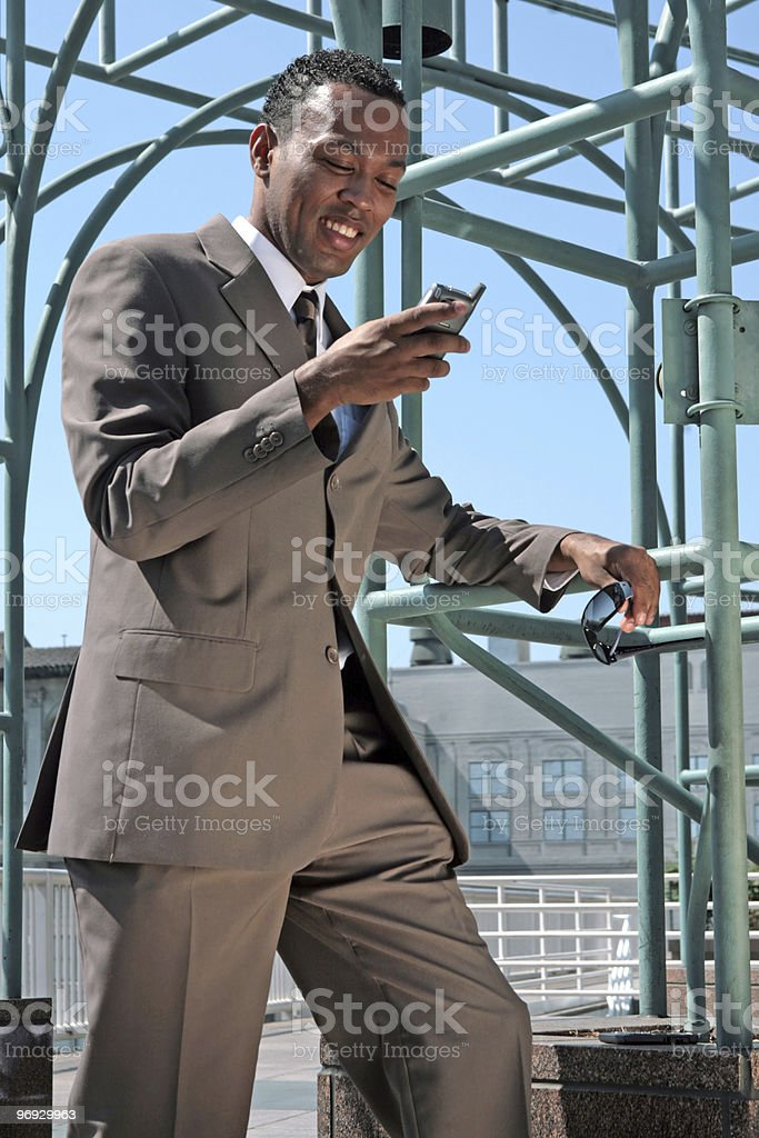 Business Man Checking His Mobile Phone Smiling royalty-free stock photo