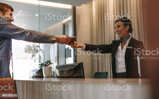 Business man checking in at hotel reception picture id964283314?b=1&k=6&m=964283314&s=612x612&h=22k0hwll8 viul7zbpa0h5odeb z o0btr3mvw8yr0i=
