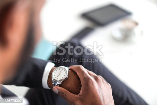 African business man checking in to a hotel.