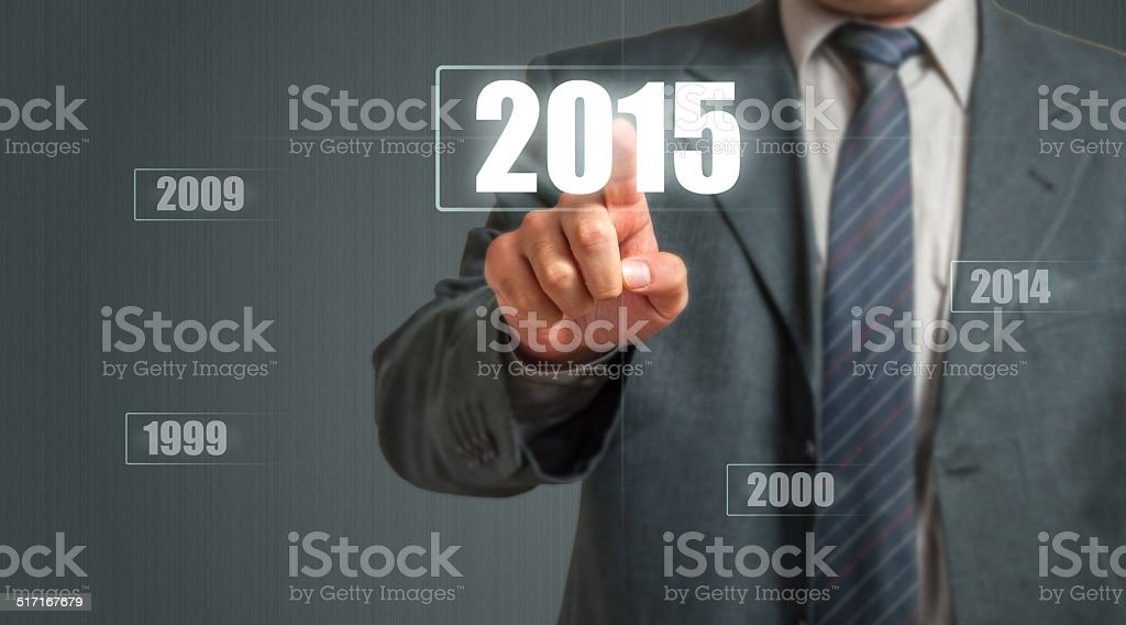 Business Man Choosing 2015 Year stock photo