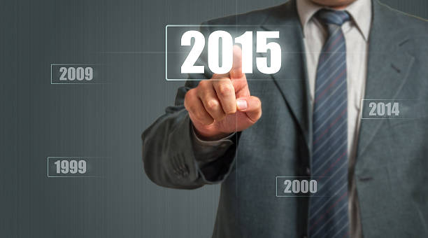 business man choosing 2015 year - 2000 2009 stock pictures, royalty-free photos & images
