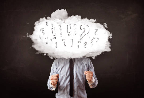 Business man cloud head with question and exclamation marks stock photo