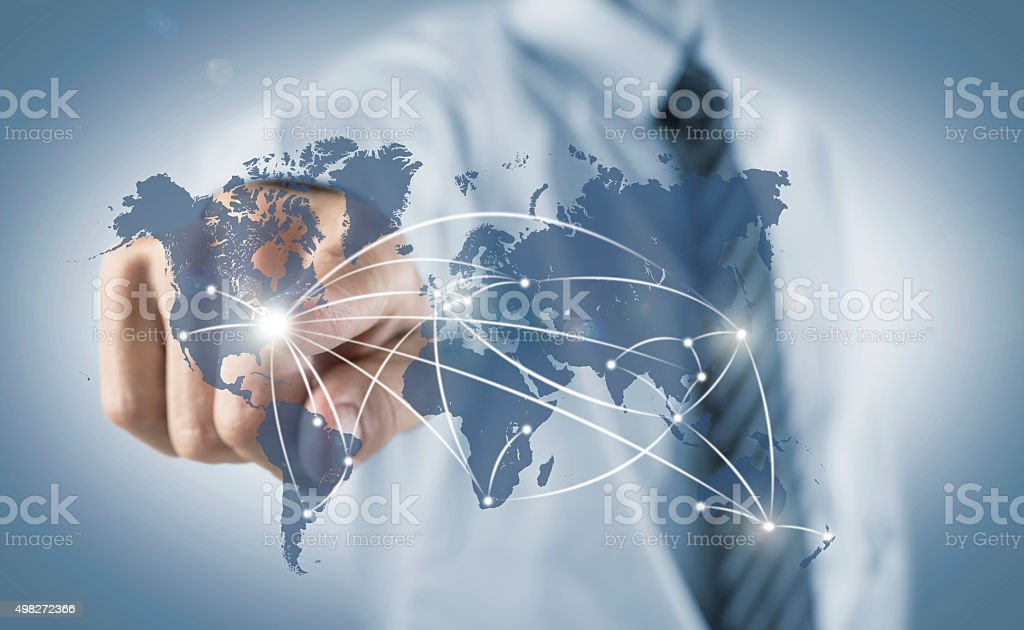 Business man connecting the World stock photo