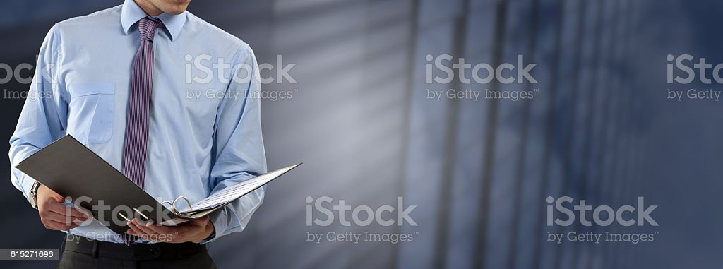 Business man consults files stock photo