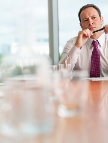 Business Man Contemplating Over Something At Work Stock Photo - Download Image Now