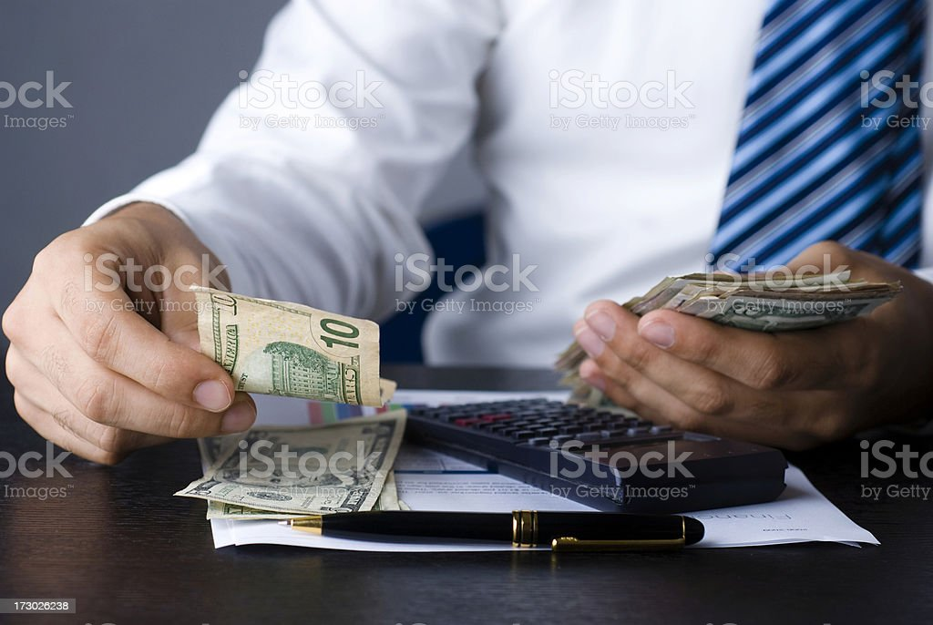 business man counting money royalty-free stock photo