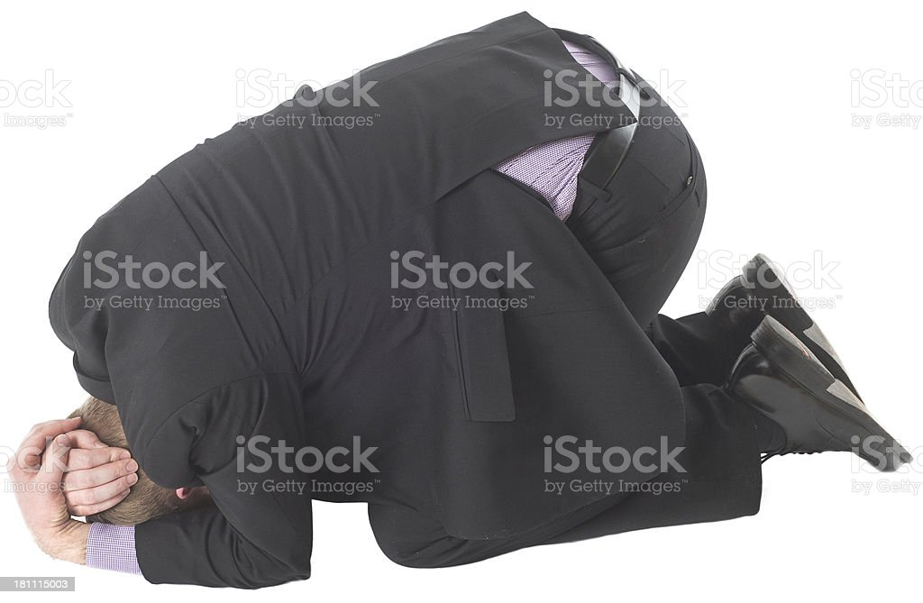 Business man covering on floor in protection position stock photo