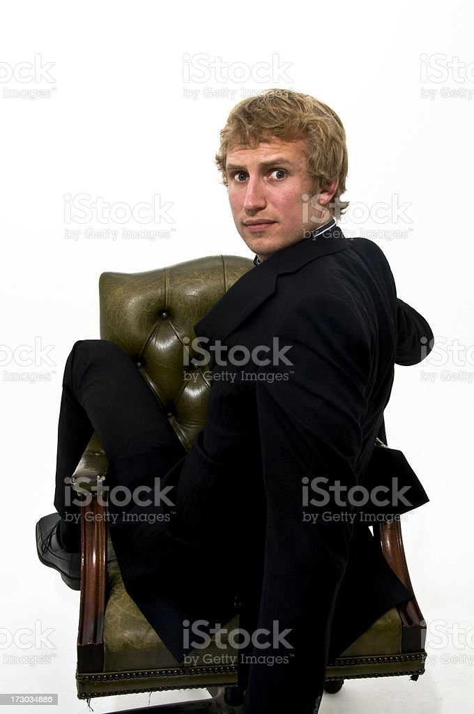 Business man Crazy sitting backwards on chair royalty-free stock photo
