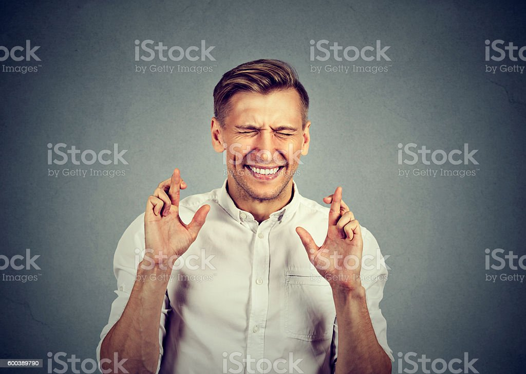 business man crossing fingers wishing hoping for best miracle - foto de stock
