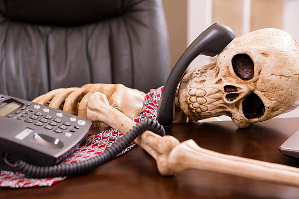 "business: man died while waiting ""on hold.""  office phone. - human skeleton stock photos and pictures"