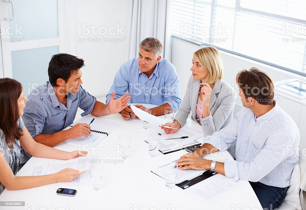 Business man discussing with teammates royalty-free stock photo