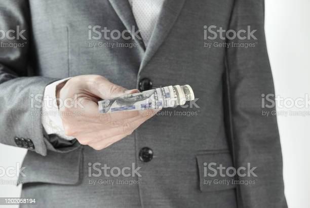 Business man displaying and giving money cash in the office on white picture id1202058194?b=1&k=6&m=1202058194&s=612x612&h=klvlbjmb jahnzbm1uqjf fgr5hgojbqsvkwvu23ydm=