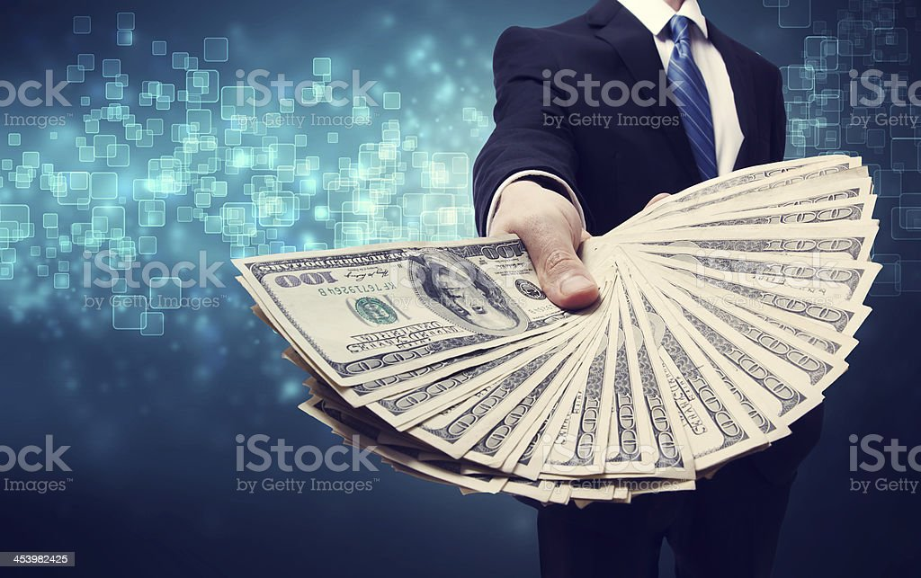 Business Man Displaying Spread of Cash stock photo