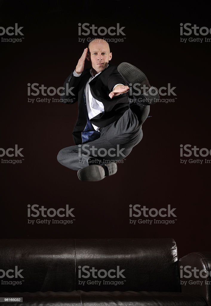 business man do a jump kick royalty-free stock photo
