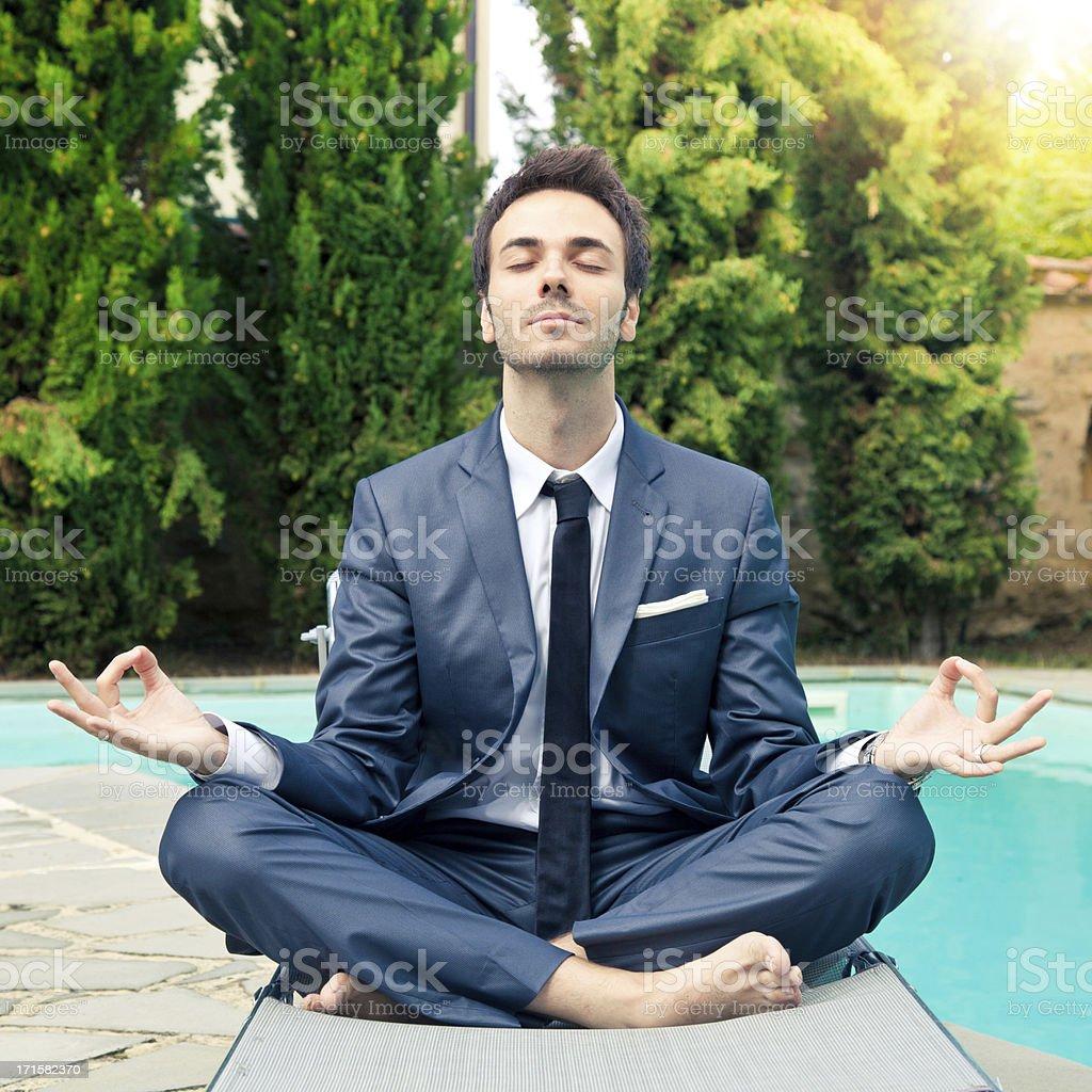 Business man doing meditation stock photo