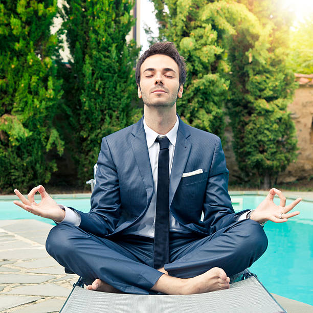 Business man doing meditation stock photo