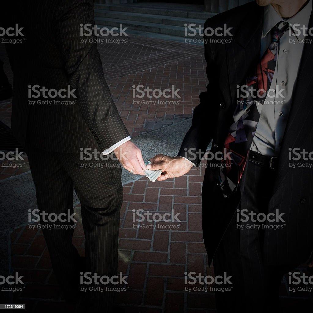 Business man doing secret business royalty-free stock photo